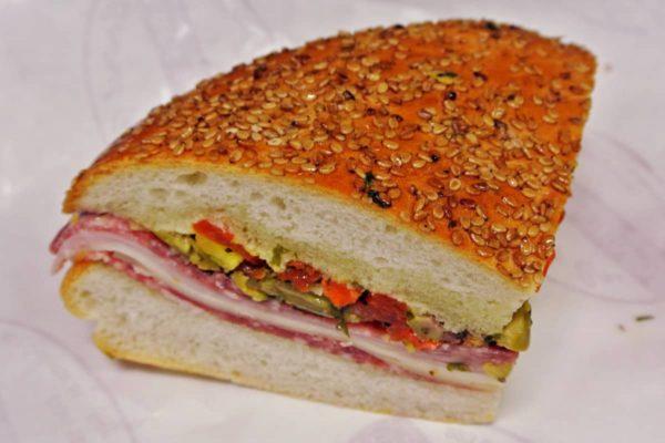 Experience New Orlean's Quintessential Muffuletta Sandwich